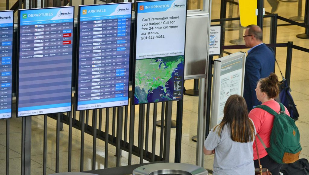 Passengers view FIDS in C ticketing