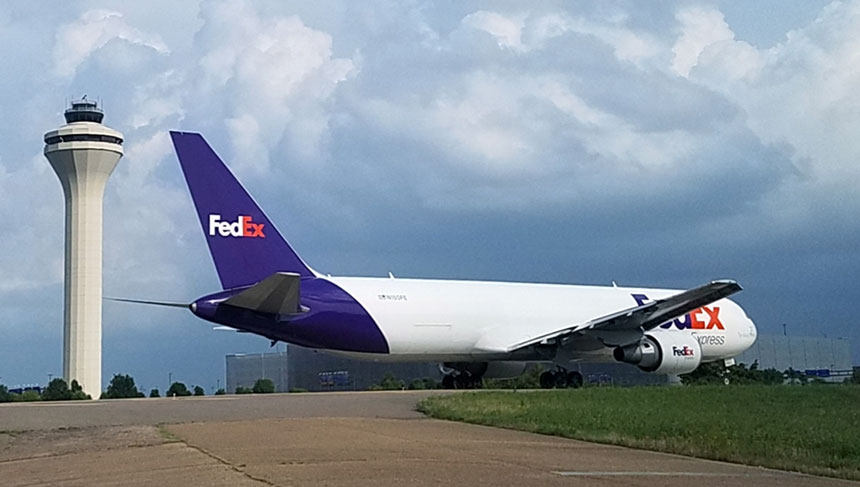 Afternoon FedEx flight on TWY N heading to RWY 18R for departure